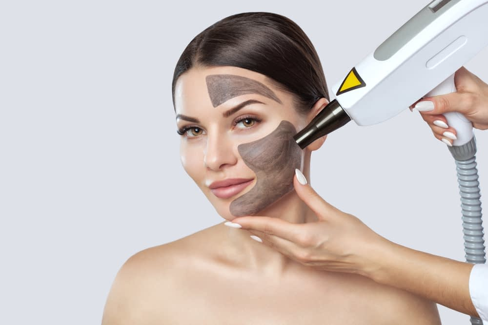 Before receiving CO2 laser resurfacing, the face is cleaned with a mask.